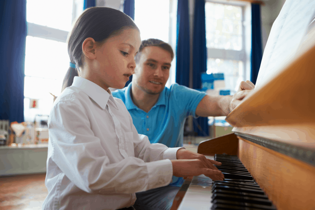 teaching piano to student